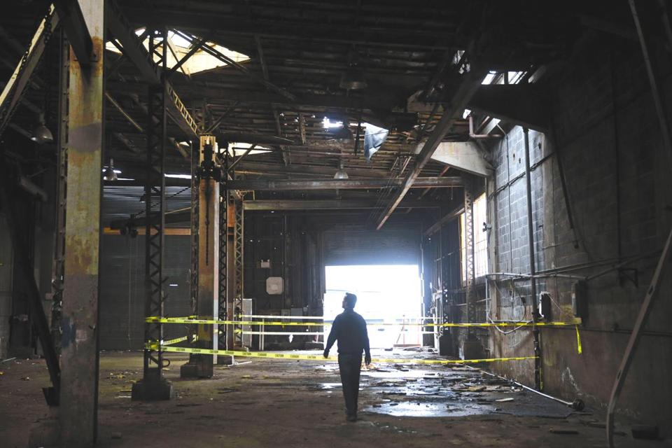 Joe Sugar, a partner in Boston Harbor Shipyard and Marina, toured the former copper pipe shop on Wednesday.